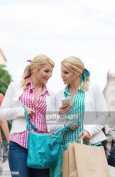 Beautiful girls with shopping bags in ctiy