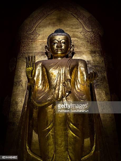 Beautiful golden Buddha statue at Ananda temple, Bagan, Mandalay