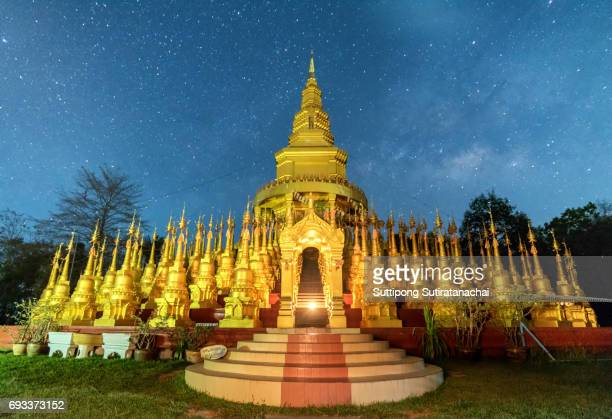 Beautiful golden pagoda of Pa sawangboon temple with milky way and star at night scene