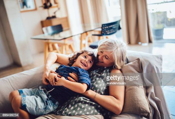 beautiful grandma and grandson playing together having fun at home - grandmother stock pictures, royalty-free photos & images