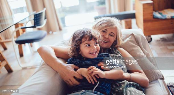Beautiful grandmother and grandson playing and laughing together