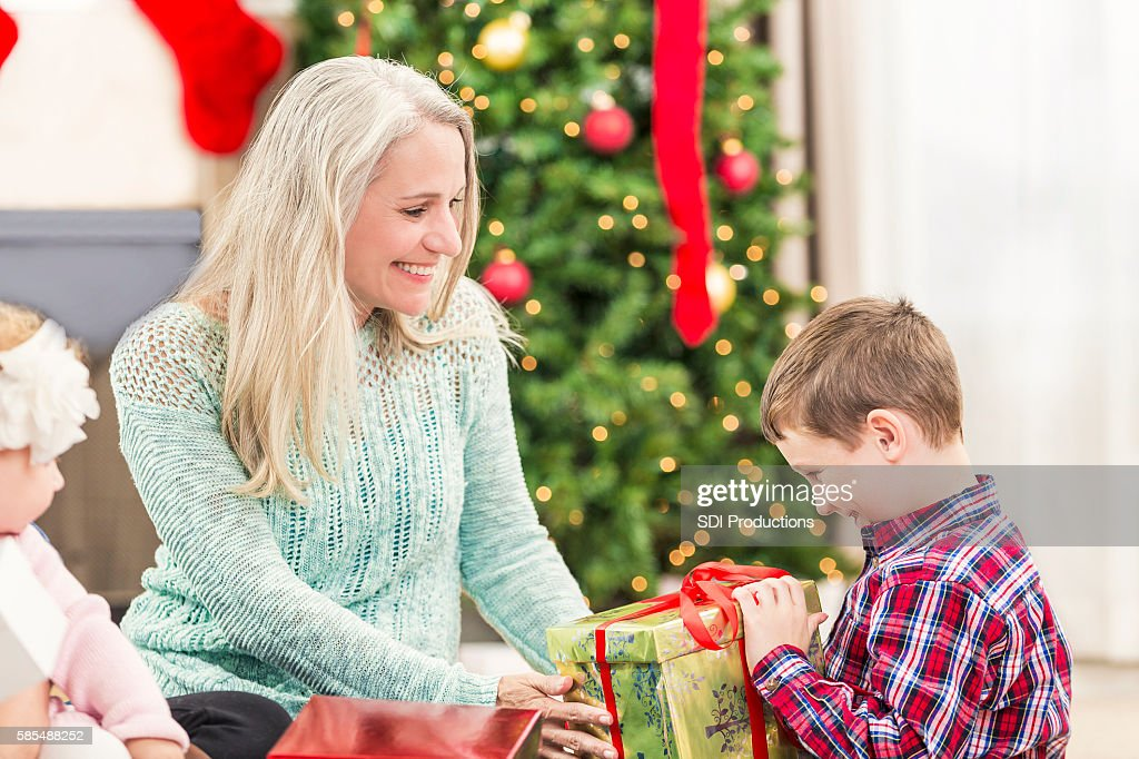 Beautiful Grandmother Gives Christmas Gifts To Her Grandchildren ...