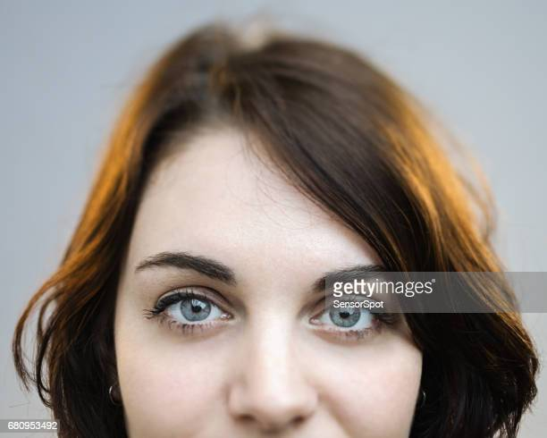 beautiful gray eyes of a woman - forehead stock pictures, royalty-free photos & images