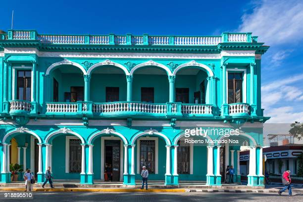 Beautiful green and white old building in one corner of the Leoncio Vidal Park which is a Cuban National Monument and tourist attraction
