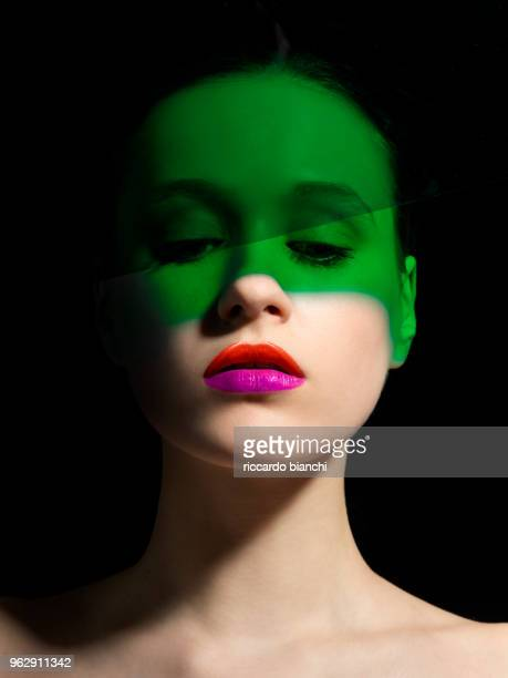 beautiful green and white woman with orange and fucsia lipstick