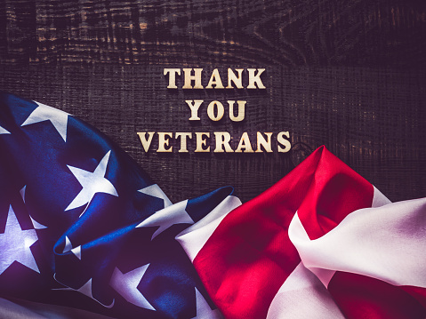 Beautiful greeting card on Veterans Day. Top view. 1176718615