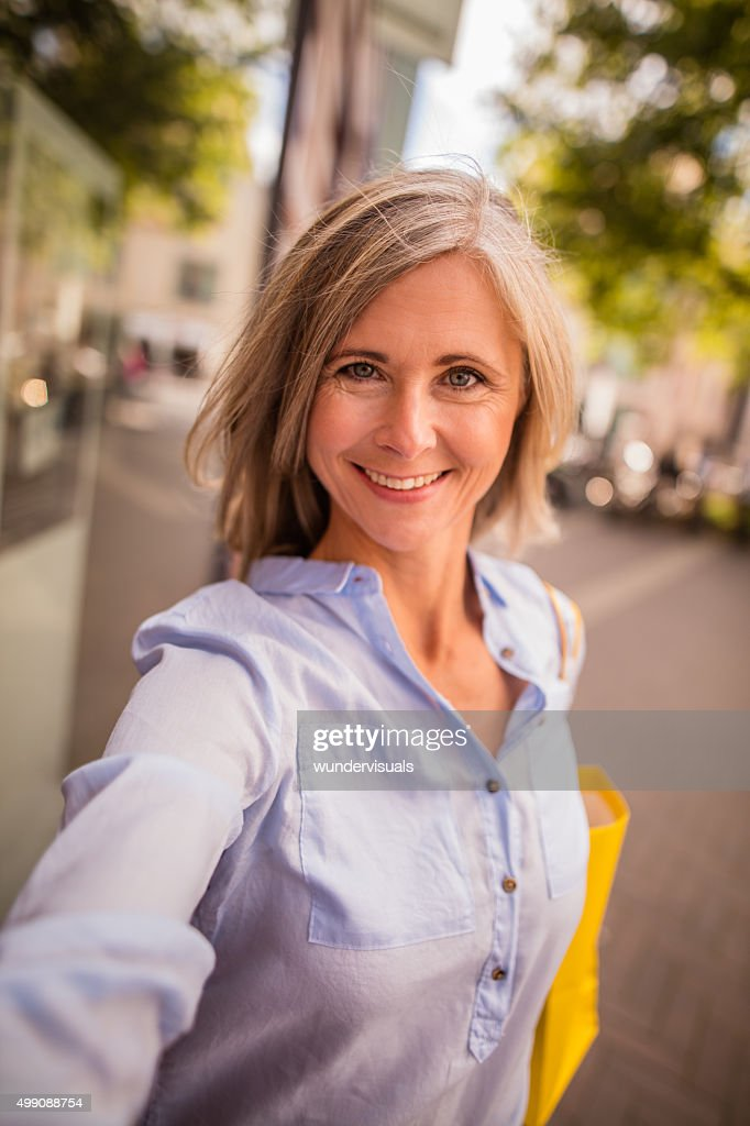 Beautiful Grey Haired Mature Woman Taking A Selfie In Town Stock Photo  Getty Images-6403