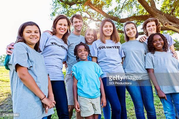 Beautiful group of happy volunteers outside