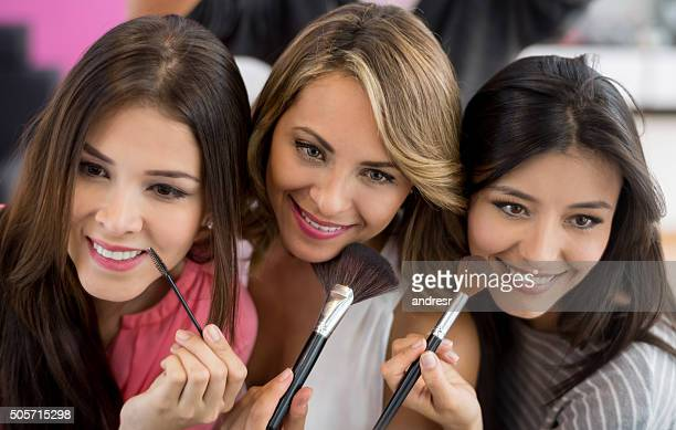 Beautiful group of women applying makeup