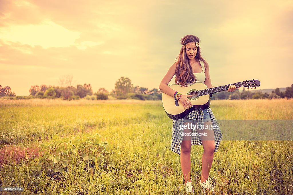 Beautiful guitarist : Stock Photo
