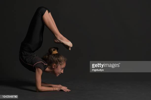 beautiful gymnast athlete teenage girl doing exercise - rhythmic gymnastics stock pictures, royalty-free photos & images