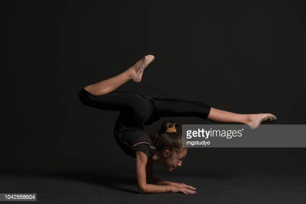 beautiful gymnast athlete teenage girl doing exercise - beautiful turkish girl stock pictures, royalty-free photos & images