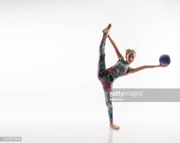 beautiful gymnast athlete teenage girl doing exercise with ball - rhythmic gymnastics stock pictures, royalty-free photos & images