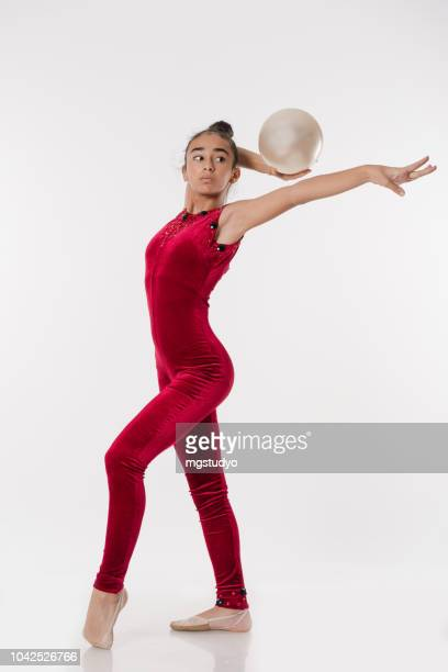 beautiful gymnast athlete teenage girl doing exercise with ball - floor gymnastics stock pictures, royalty-free photos & images