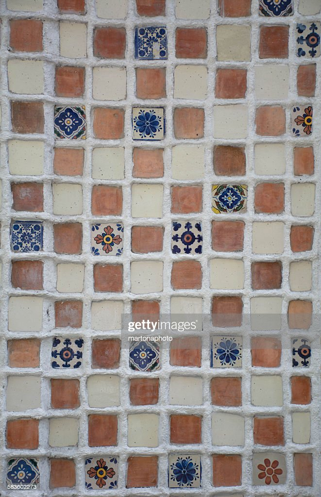 Beautiful handmade tiles forming a mosaic on a wal : Stock Photo