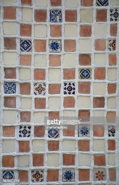 Beautiful handmade tiles forming a mosaic on a wal