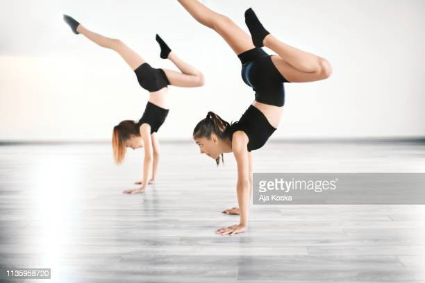 beautiful handstand. - acrobatic activity stock pictures, royalty-free photos & images