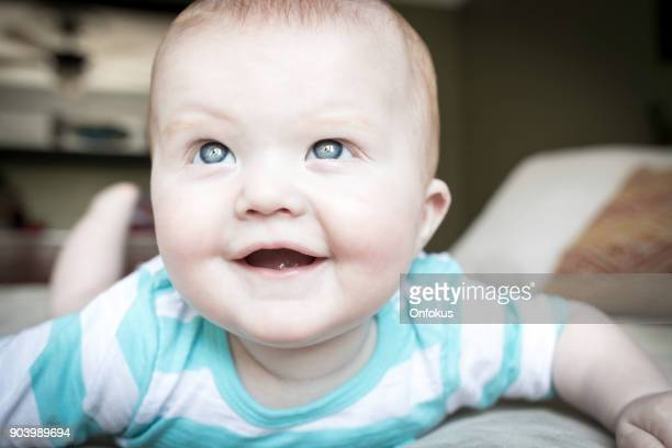 Beautiful Happy Baby Boy Playing On Bed