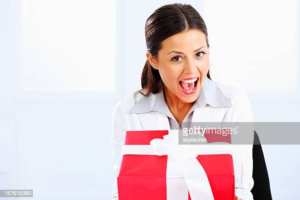 Beautiful happy business woman with present.