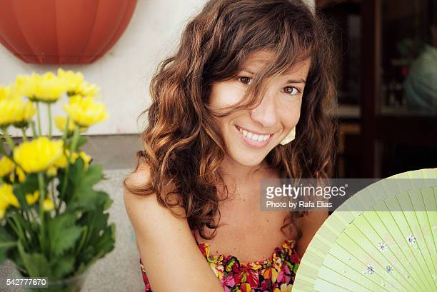 beautiful happy lady holding fan - hot spanish women stock pictures, royalty-free photos & images