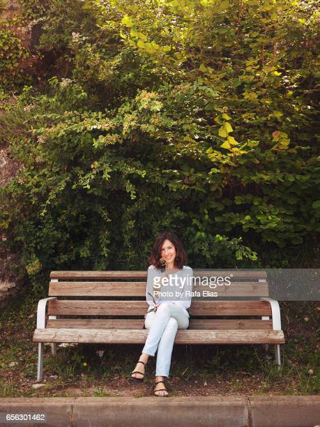 Beautiful happy lady sitting on sofa