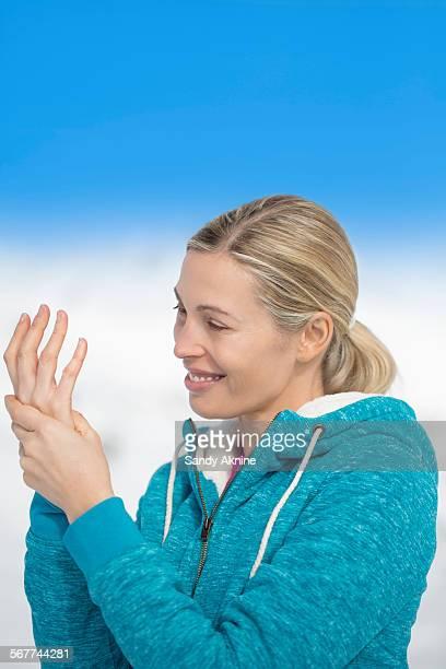 Beautiful happy woman applying moisturizer, Crans-Montana, Swiss Alps, Switzerland