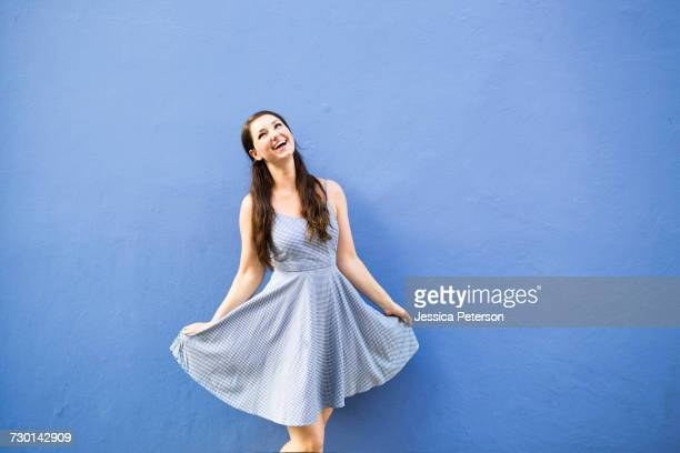 beautiful happy woman dancing - blue dress stock pictures, royalty-free photos & images