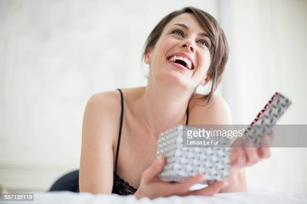 Beautiful happy woman holding a gift box