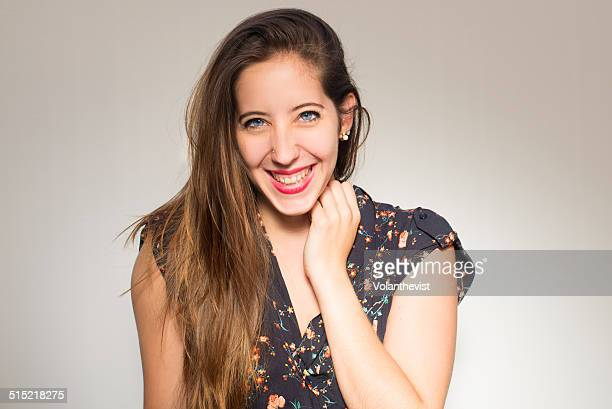Beautiful happy woman laughing w/ hand on hair