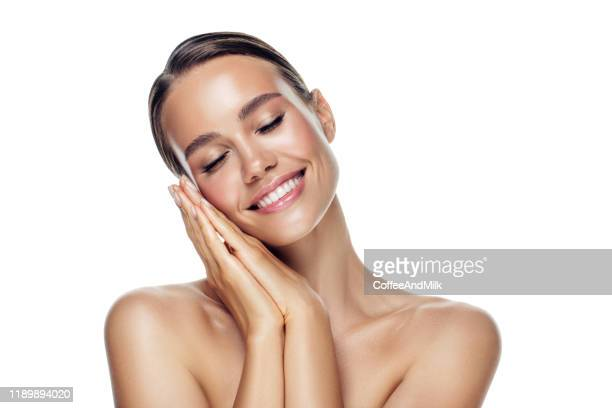beautiful happy woman - touching stock pictures, royalty-free photos & images