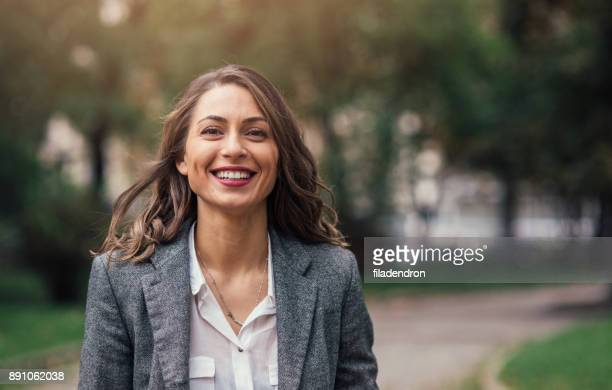 beautiful happy woman - brown hair stock pictures, royalty-free photos & images