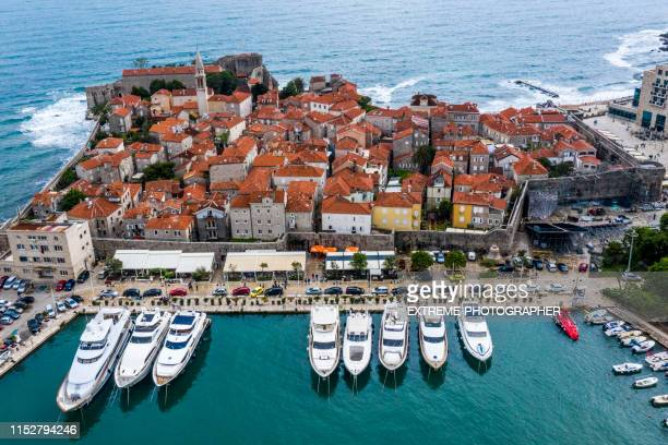beautiful high angle perspective of old town of budva and piers in the adriatic sea - montenegro stock pictures, royalty-free photos & images