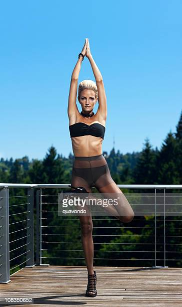 beautiful blond woman in lingerie, high fashion yoga outdoors - women wearing pantyhose stock photos and pictures