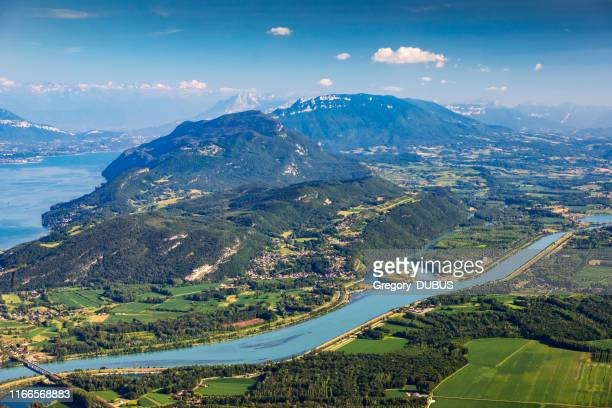 beautiful hilly french landscape aerial view in middle of bugey mountains in ain department near savoie, with rhone river, vibrant green fields and famous lake bourget not far, shot in summer - auvergne rhône alpes stock pictures, royalty-free photos & images