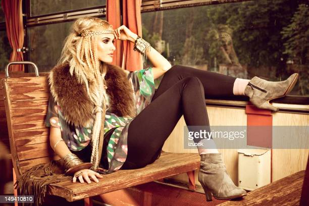 Beautiful hippie in vintage train