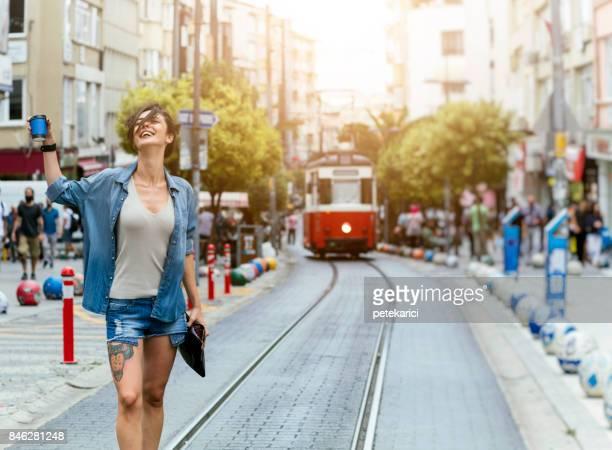 beautiful hipster woman having fun on street - kadikoy stock photos and pictures