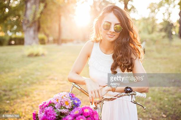Beautiful hipster woman smiling on a sunny spring day