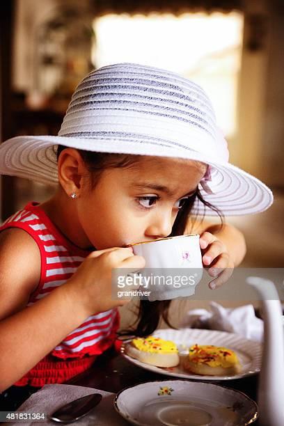 Beautiful Hispanic African American Girl Having a Tea Party