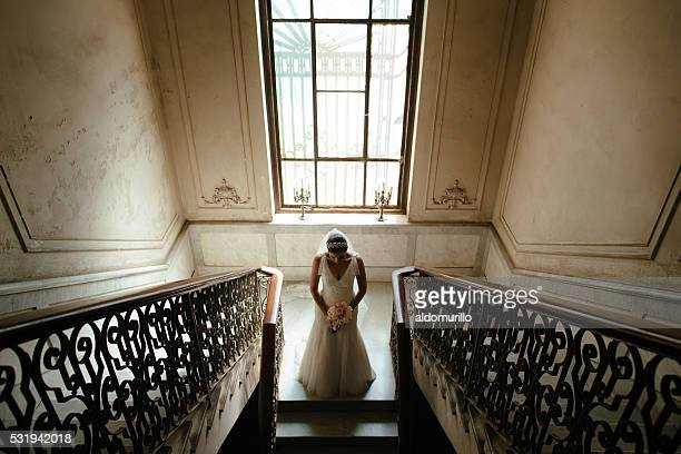 Beautiful Hispanic Bride standing in front of a stairway
