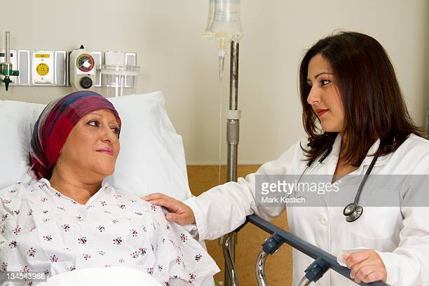 Beautiful Hispanic Medical Professional Consoling a Patient