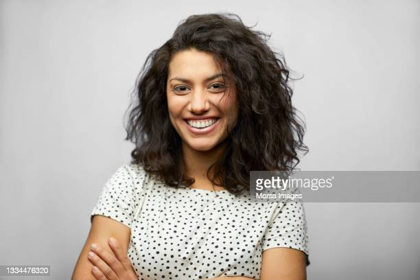 beautiful hispanic woman against white background - black hair stock pictures, royalty-free photos & images