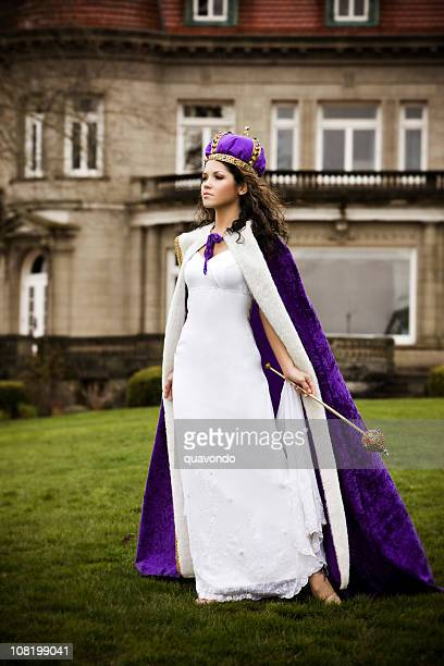 Beautiful Hispanic Young Woman as Queen Outside Castle