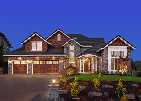 Beautiful Home Exterior at Night 471104670