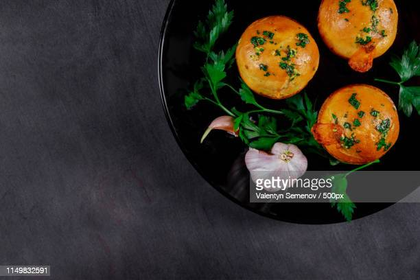 beautiful homemade meat with garlic pies on wooden gray boards - crosta di formaggio foto e immagini stock