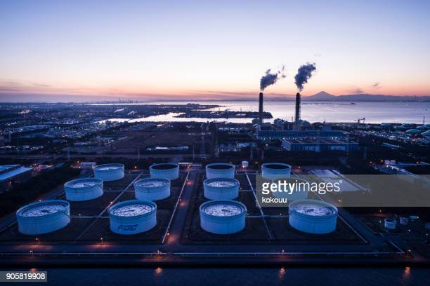 a beautiful horizon and smoke emerging from the chimney. - oil refinery stock pictures, royalty-free photos & images