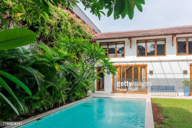 beautiful house exterior with swimming pool - holiday villa stock pictures, royalty-free photos & images