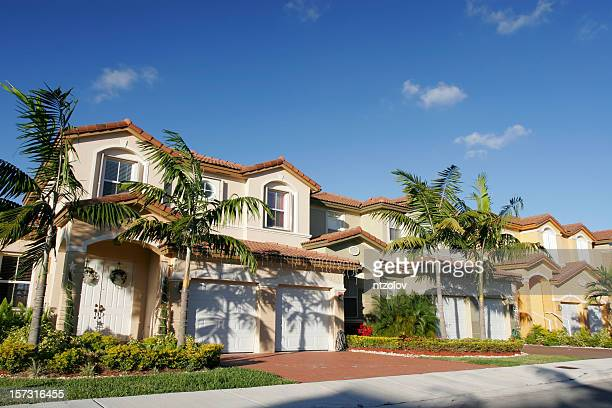 a beautiful house for a single family with palm trees - spanish culture stock pictures, royalty-free photos & images