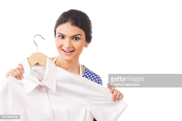 beautiful housewife showing a shirt