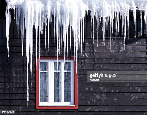 Beautiful icicles cascading from a roof and providing a view