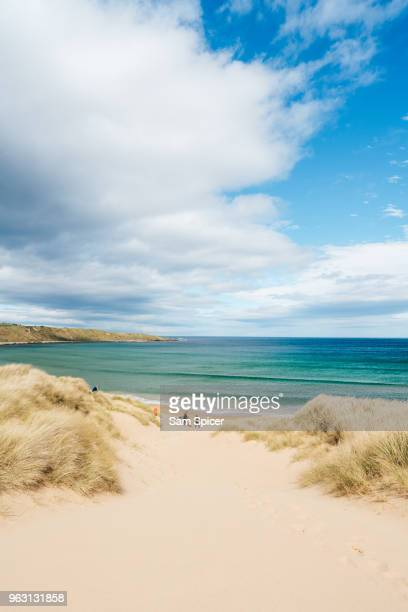 Beautiful idyllic beach with clear sky and turquoise water, Scotland